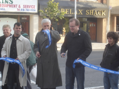 Councillor Bill Saundercook and Martin Lennox of the JRA with Pascal Abboud chair of the Junction BIA cutting the ribbon