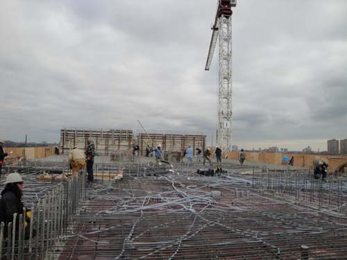 Elecrtical systems and plumbing systems go in before the floor slab is poured, One floor  (slab and walls is the production timing.
