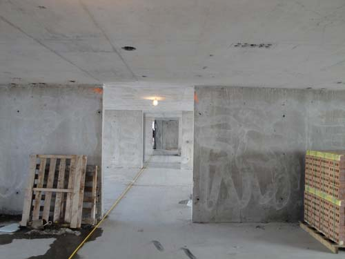 INSIDE the view down one the hallways in the buildings - note the fine working of the poured concrete